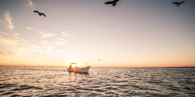 small fishing vessel at sunset
